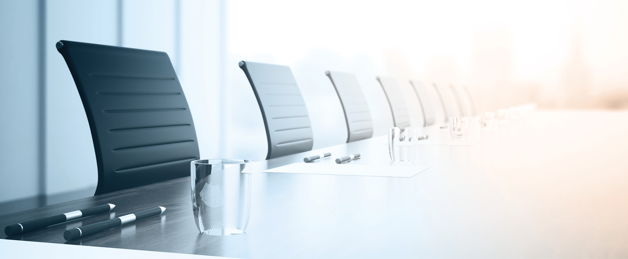 Close up of empty boardroom table with chairs