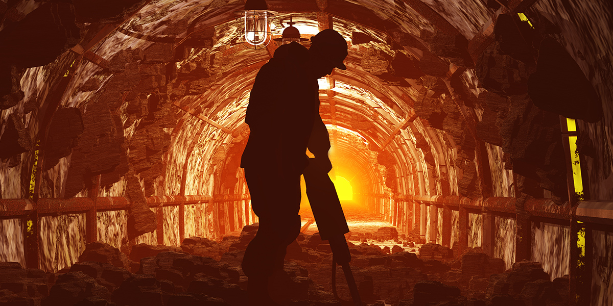 Man in a mine drilling